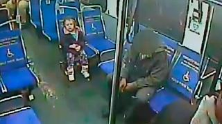 Shivering toddler boards bus alone at night for slushie - Video