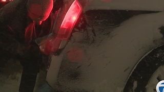 Blizzard-like conditions leave drivers stuck in downtown Buffalo - Video