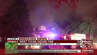 Firefighters dealing with house fire in West Tulsa - Video