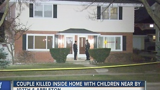 Couple killed inside home with children nearby - Video