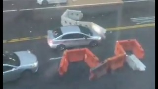 Sudden NYC Storm Blows Construction Barriers Into Traffic - Video