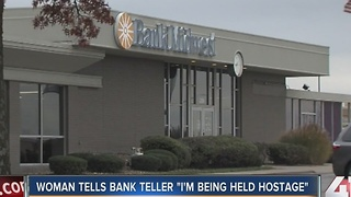 "Woman tells bank teller ""I'm being held hostage"""