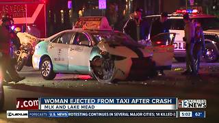 Woman ejected from taxi during crash - Video