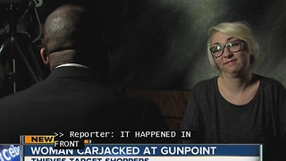 Woman Carjacked at gunpoint - Video