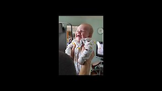 Cute baby laughing at dads funny face