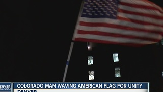 Colorado man waving American flag for unity - Video