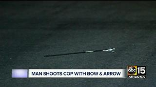 Man accused of shooting officer with bow and arrow - Video
