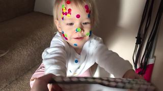 Little Girl Puts Stickers On Everything, Even On The Dog!