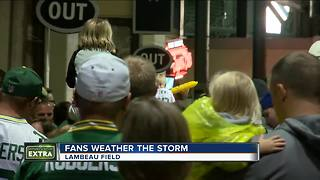 Storms force Packers' fans to briefly evacuate Lambeau Field bowl during Family Night - Video