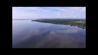 Breathtaking drone footage takes viewers high above a lake in Quebec