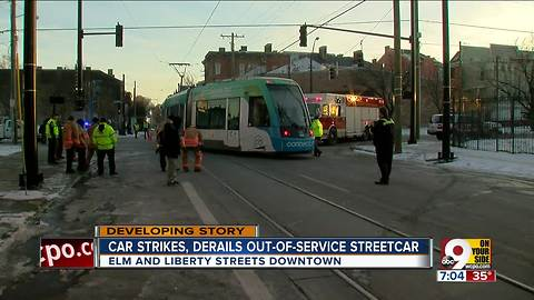 Car hits, derails out-of-service streetcar