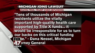 Michigan joins suit over defunding