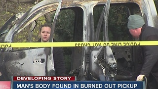 Man's body found in burned out pickup truck - Video