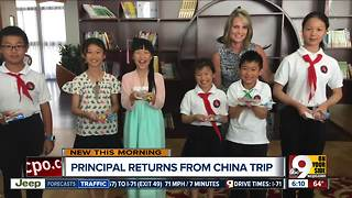 Principal returns from trip to China - Video
