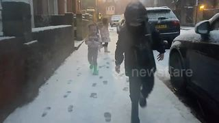 Children run out into snowy street