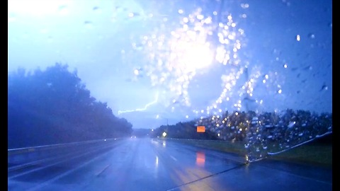 Spectacular lightning caught on dashcam while driving during storm