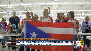 Volunteers pack 150K+ meals for Puerto Rico - Video