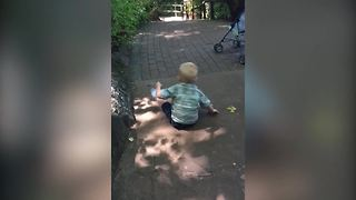 Little Boy Thinks That A Hill Is A Slide - Video