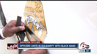 Officers unite in solidarity with black band - Video