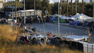 Greek Authorities Move Migrants To New Camp After Fires