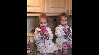 Cute little girls enjoy their morning tea