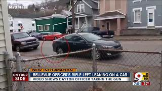 Officer's rifle left leaning on a car - Video