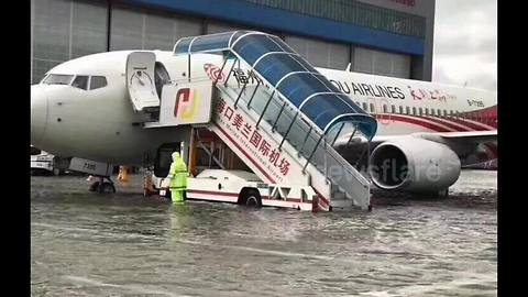 Planes submerged in floodwaters after torrential rain