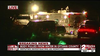 Officials investigating homicide after body recovered from water in Ottawa County
