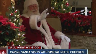 Caring Santa visits with special needs children - Video