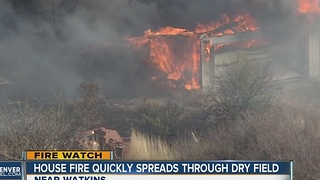 Buildings burn in small grass fire near Watkins - Video