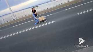 Man takes a nap in the middle of the road - Video