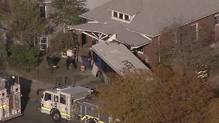 Bus slams into Denver home - Video