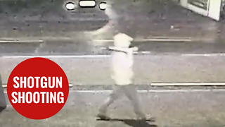 Man walking down a street holding a 'SHOTGUN,' moments before he was shot dead