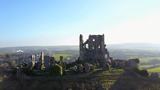 Drone footage of the beautiful Corfe Castle, UK - Video