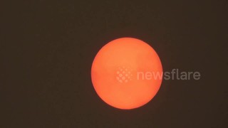 Stunning close-up of 'red sun' phenomenon over the West Midlands - Video