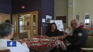 Oneida officers tie blankets with community - Video