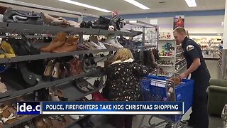 Police, firefighters take kids Christmas shopping