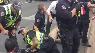 Police Officer Appears to Kick Photographer During Alice Springs Protest - Video