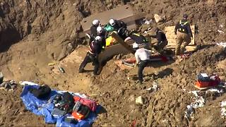 Crews rescue man stuck in waist-deep mud - Video