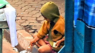 Young Indian boy tries to set trash on fire with matches  - Video