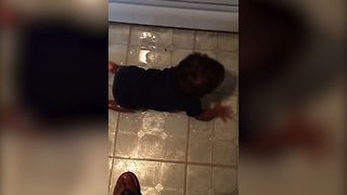 Baby Gets Into Oil, Slides All Over The Kitchen - Video
