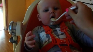 Baby having fun while eating, mom not so much!