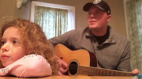 A man and his Goddaughter sing an autism inspired song for a family member