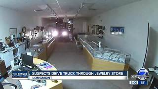 Suspects drive truck through jewerly store - Video