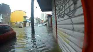 Guadeloupe Resident Wades Through Hurricane Maria Floods - Video