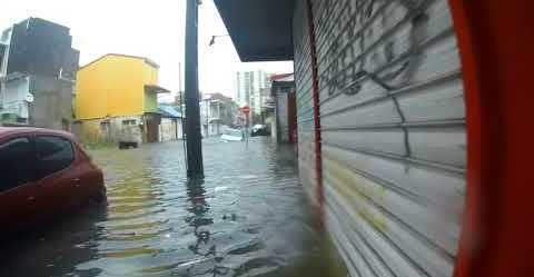 Guadeloupe Resident Wades Through Hurricane Maria Floods