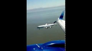 Close Call Between Two Planes Attempting to Land - Video