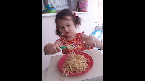 Novel way to eat spaghetti at 3 years old!