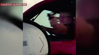 Woman accused of pointing fake gun at motorists to get through traffic - Video