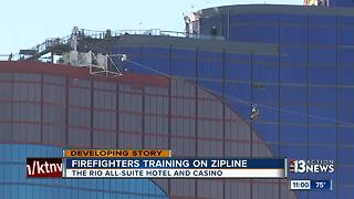 Firefighters practicing rescue on zip line - Video